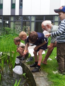 Children pond dipping with Alan at the Big Lunch.